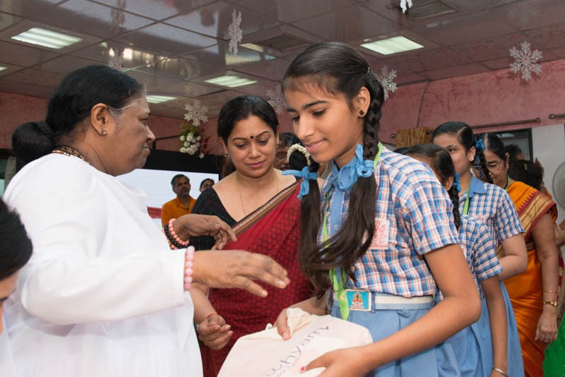 Amma distributing Saukhyam pads during International Women' s Day